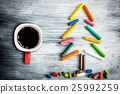 Christmas tree made of crayons and cup of coffee 25992259