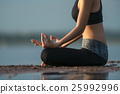 hand of a woman meditating in a yoga  25992996