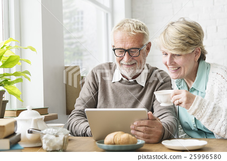 Senior Adult using Digital Device Tablet Concept 25996580