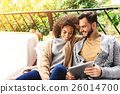 guy and girl relaxing on a terrace 26014700