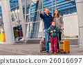 Smiling family with child at airport 26016697
