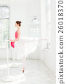 Ballerina posing in pointe shoes at white wooden 26018370
