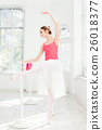 Ballerina posing in pointe shoes at white wooden 26018377