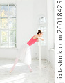 Ballerina posing in pointe shoes at white wooden 26018425