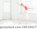 Ballerina posing in pointe shoes at white wooden 26018427