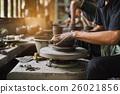 potter's hands make an earthen pot 26021856