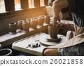 potter's hands make an earthen pot 26021858