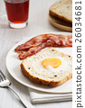 egg in a hole and crispy bacon 26034681