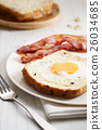egg in a hole and crispy bacon 26034685