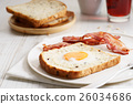 egg in a hole and crispy bacon 26034686