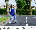 little girl doing rollerblade in the street 26038245