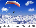 Paragliding over the mountains  26064194