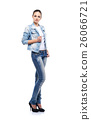 Young and beautiful girl in denim jeans on white 26066721