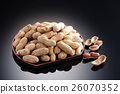 Dried salted peanuts on black plate in restaura 26070352