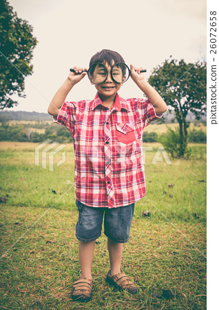 Full body. Asian boy with magnifying glass 26072658