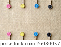 Wooden clothespins on burlap sack background. 26080057