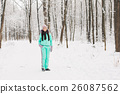 Beautiful young girl in a white winter forest 26087562