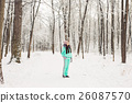 Beautiful young girl in a white winter forest 26087570