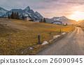 Country road toward alpine village 26090945