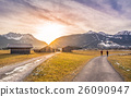 Winter sunset over alpine country roads 26090947