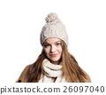 Girl in winter coat, scarf and hat, studio shot 26097040