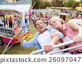 Senior couple on a ride in amusement park 26097047