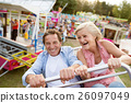 Senior couple on a ride in amusement park 26097049