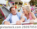 Senior couple on a ride in amusement park 26097050