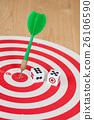 Dice on dart board with green dart arrow 26106590