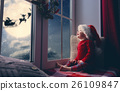 baby girl sitting by the window 26109847