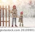 girls playing on a winter walk 26109901