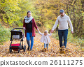 Beautiful young family on a walk in autumn forest. 26111275