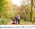 Beautiful young family on a walk in autumn forest. 26111277
