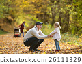 Beautiful young family on a walk in autumn forest. 26111329