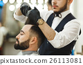 Barber doing haircuts for client 26113081