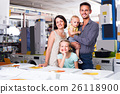 parents with kids in store 26118900