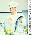 Female cook preparing big fish 26119294
