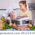 Girl and mom cooking with multicooker. 26121419