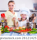 Girl helping mother to prepare 26121425