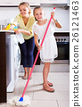 Family of two washing kitchen 26121463