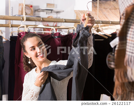 Woman buying breeches at the store . 26122117