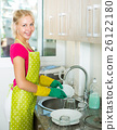 Young smiling girl wearing apron 26122180