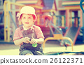 Portrait of two-year child at playground 26122371