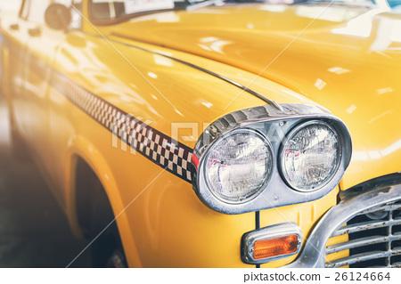 Close up headlight of yellow Retro classic car 26124664