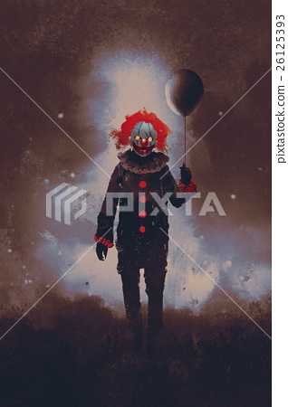 evil clown standing with a black balloon  26125393