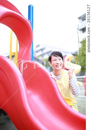 Nursery teacher (male work apron father nursery school child welfare facility athletic playground park daycare center) 26136127