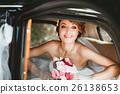 Beautiful bride sitting in wedding car 26138653