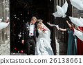 Bride and groom going out of church  26138661