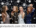 happy young women dancing over snow 26141026