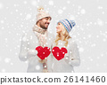 smiling couple in winter clothes with red hearts 26141460